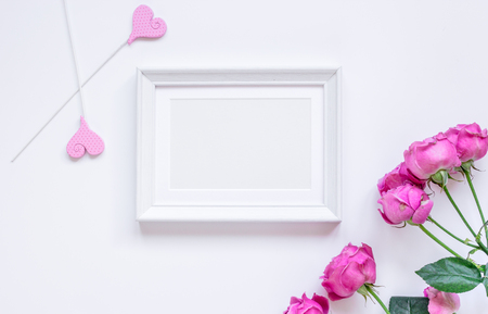 Spring design with peony flower and frame white background top view mock-up Stock Photo