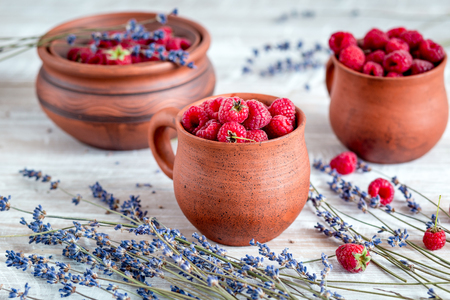 fresh raspberry and dry lavander in rustic design on wooden background Stock Photo