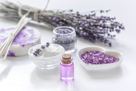 salt flat: Lavender flowers in organic cosmetic set on white background