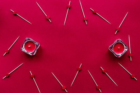 toothpick: scarlet collection with candles on red colored desk background top view space for text Stock Photo