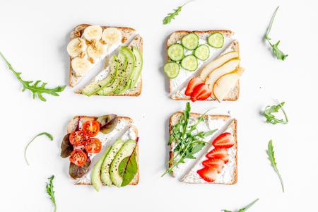 banana bread: healthy breakfast with sandwiches set on white table background top view