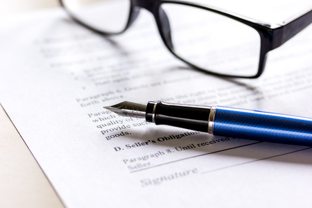 autograph: office desk with signing contract, glasses and pen for business Stock Photo