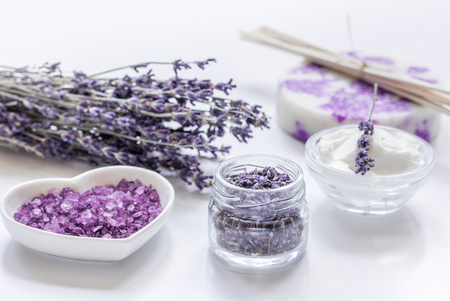salt flat: organic cosmetic with lavender flowers and bath salt on white background
