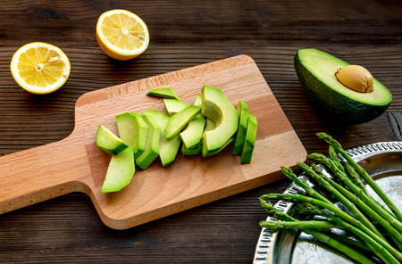 sliced avocado for homemade sandwiches on kitchen table Stock Photo