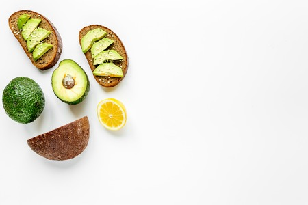 making healthy lunch with bread and avocado kitchen top view mock up Stock Photo