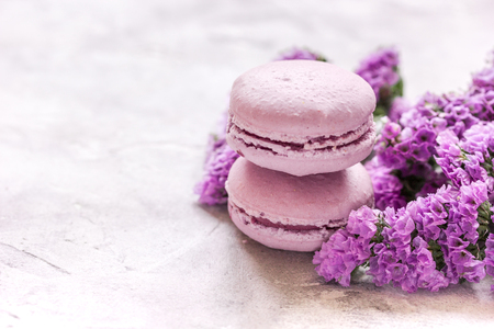 lady morning with macaroons and mauve flowers white desk background