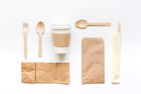 Food Delivery With Paper Bags And Plastic Cup On Gray Table
