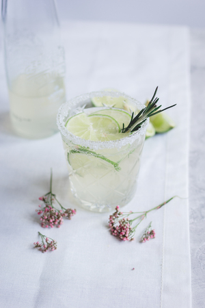 breackfast: summer homemade juice with lime and blossom on stone table background Stock Photo