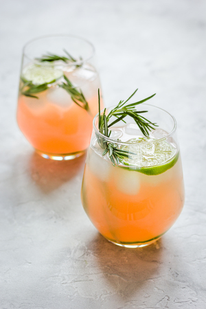 breackfast: healthy morning with fresh drink, lime and rosemary on stone table background Stock Photo