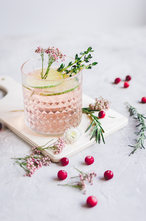breackfast: pink fresh cocktail with berry and cut lime on stone desk background