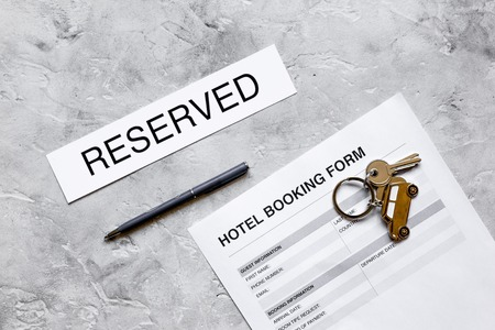 booking hotel room application form stone desk background top view mock up