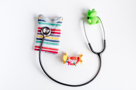 pediatrist: Child health care with stethoscope in doctors office top view