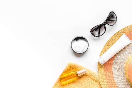 Sun glasses, protiction cream, hat, towel for beach rest white background top view mock-up Foto de archivo