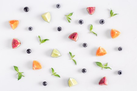 cut fruit pattern with mint on white desk background top view