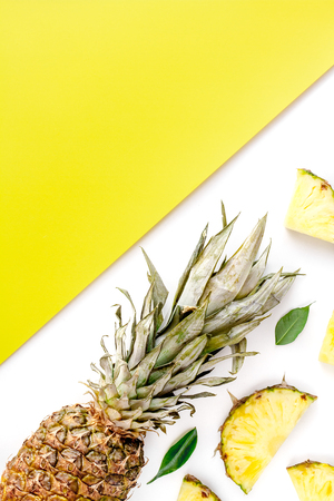 sliced pineapple in exotic summer fruit design on yellow and white background top view mock-up