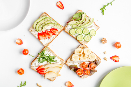 sandwiches set on white table background top view Stock Photo