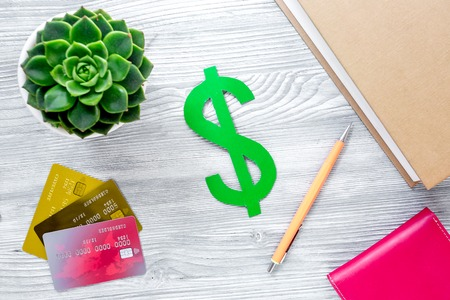 paying for studing concept with dollar sign and cards on light table background top view Stock Photo