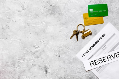 booking form for hotel room reservation stone background top view space for text Reklamní fotografie