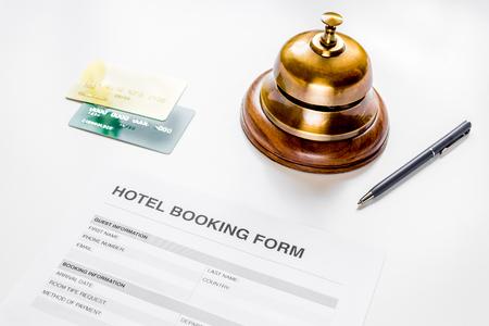 hotel reservation blank and ring on white background Reklamní fotografie
