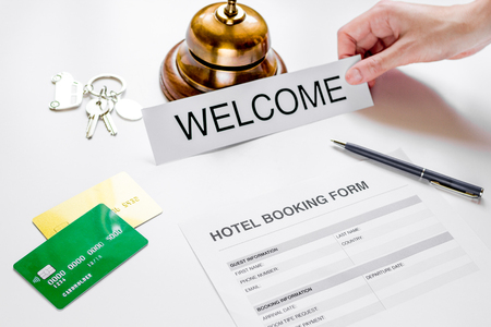 booking form for hotel room reservation on white table background Stock Photo