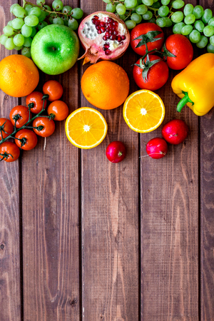 diet food with fresh fruits and vegetables salad on wooden background top view mockup