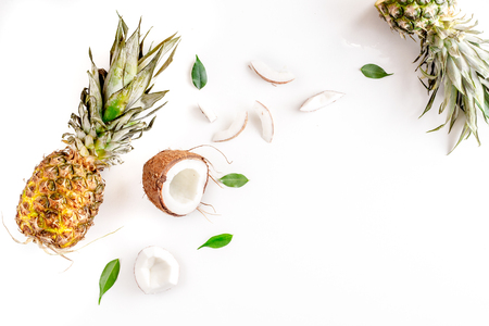 summer dessert with pineapples and coconut on white table background top view mock up