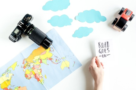 stuff toy: children tourism outfit with map and camera on white background flat lay mockup