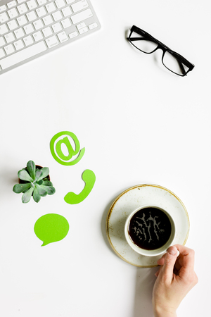 Company feed back concept with coffee and keyboard white background top view