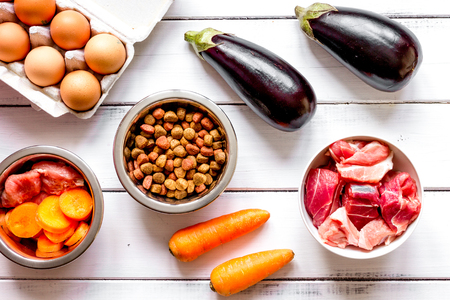 holistic view: ingredients for pet food holistic top view on wooden background Stock Photo