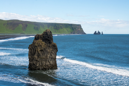 erupting: Black sand beach, Reynisfjara shore near the village Vik, atlantic ocean, Iceland