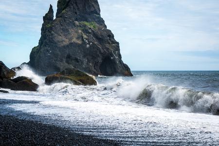 Black sand beach, Reynisfjara shore near the village Vik, atlantic ocean, Iceland