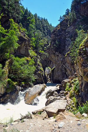 River and waterfall in forest, mountains of Caucasus, Russia