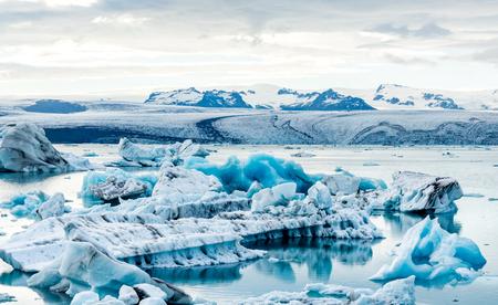 Floating icebergs in the glacial lake Jokulsarlon in Iceland.
