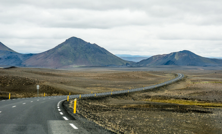 curve road: Beautiful mountains and dramatic sky along the road in Iceland