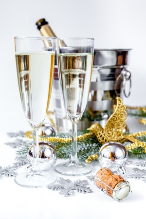 glasses of champagne and christmas ornaments on white background stock photo 85580890