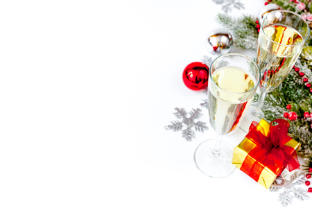 glasses of champagne and christmas ornaments top view on white background stock photo 86209811