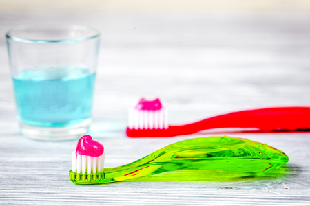 childrens toothbrush oral care on wooden background.