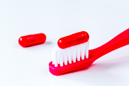concept toothache with toothbrush and tablet at white background Stock Photo