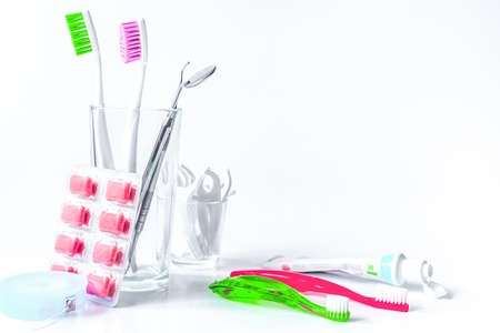 toothbrushes in glass on white background tools for oral care. Standard-Bild