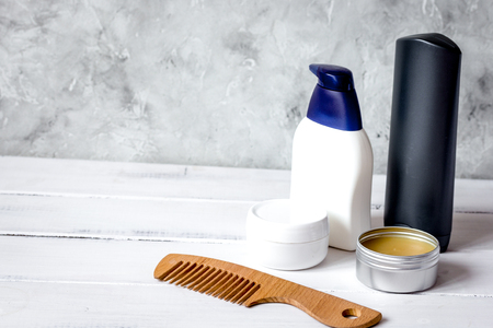 Men's cosmetics for hair care on wooden background close up 스톡 콘텐츠