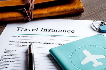 concept booking travel insurance on wooden background close up 版權商用圖片