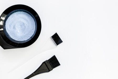 Tools for hair dye and hairdye top view white background 版權商用圖片