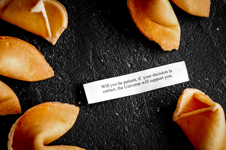 Chinese fortune cookie with prediction on dark background top vi