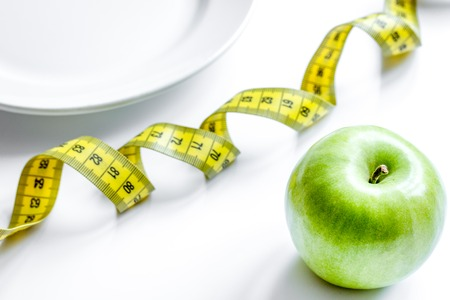 Concept diet and weight loss on white background top view. Stock Photo