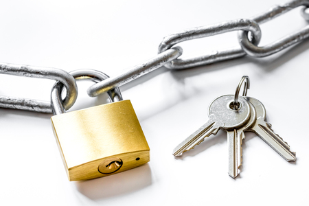 Concept data protection with metal chain on white background close up