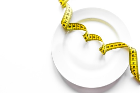 concept diet and weight loss on white background top view.
