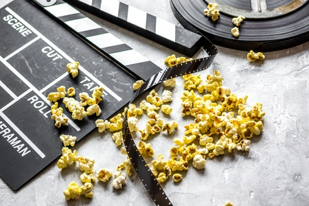 watching movie with popcorn on gray background close up. Stock Photo