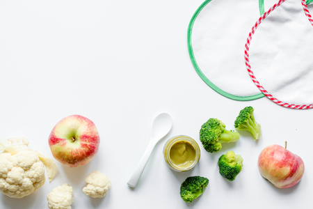 cooking vegetable puree for baby on white background top view Banco de Imagens