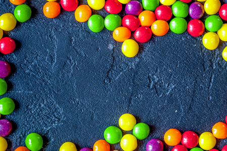 sweets and sugar candies on dark background top view Stock Photo