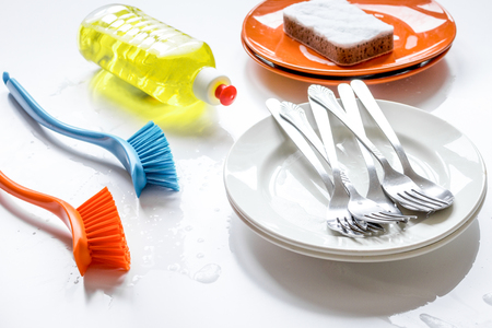 concept of washing dishes on white background